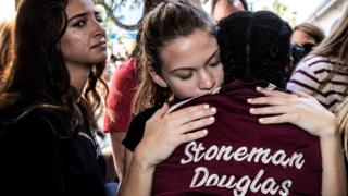 Students from Stoneman Douglas High School attend a memorial following the shooting
