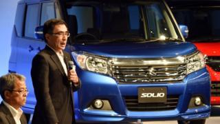 Suzuki Motor president Toshihiro Suzuki introduces the company's 'Solio' wagon in Tokyo