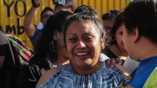 Evelyn Hernandez smiling as she leaves the prison where she was serving her sentence