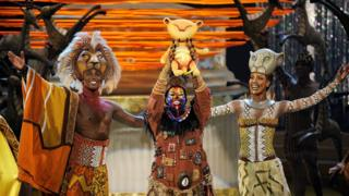 actors perform in the Lion King stage show.