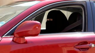 A woman drives a car in Riyadh, Saudi Arabia on 22 October 2013