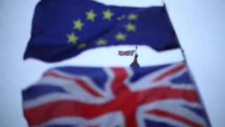 Union Jack and EU flags outside Parliament