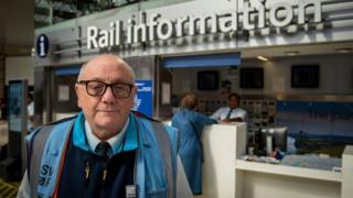 Jeffery Fry in his blue hi-vis jacket at Waterloo station