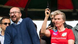 Belgian Prime Minister Charles Michel reacts as Princess Astrid of Belgium gives the start of the 38th edition of the Brussels' 20km run on May 28, 2017, in Brussels.