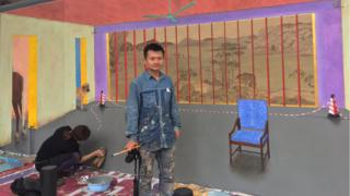 Hu Jiamin and Marine Brossard beside their mural