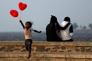 A child jumps from a promenade in Mumbai, India.