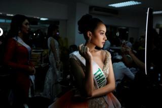 Kanwara Kaewjin prepares backstage at the Miss International Queen 2019 transgender beauty pageant