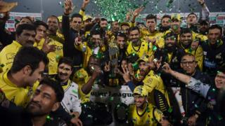 Cricketers of Peshawar Zalmi their victory over Quetta Gladiators in the final cricket match of the Pakistan Super League (PSL) at The Gaddafi Cricket Stadium in Lahore on March 5, 2017.