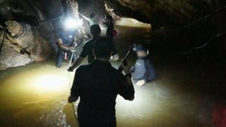 Rescuers inside the cave
