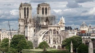 A general view of the East face of Notre-Dame Cathedral and the Seine river in Paris
