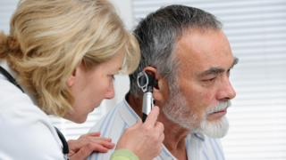 Deaf person is examined by GP
