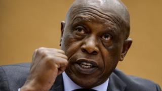 Tokyo Sexwale gestures on October 7, 2013 during a working group meeting on racism and football at the United Nations offices in Geneva