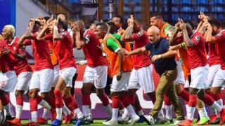 Les joueurs de l'équipe nationale de football de Madagascar célébrant leur victoire