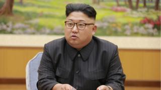 Kim Jong-un akiwa katika mkutano mwaka 2017