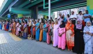 Women stand in a line to take part in a 'women's wall' protest in Kochi in Kerala on 1 January 2019.