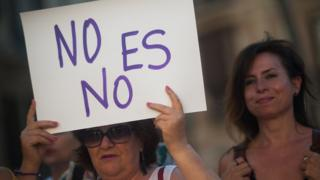 A woman holds a placard during a protest against sexual violence in Malaga, Spain, 21 June 2019