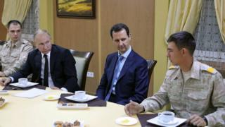 President Putin (2nd L) and Syria's President Assad (C) at Hmeimim airbase in Syria, 11 Dec 17