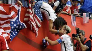 Abby Wambach kisses wife Sarah Huffman