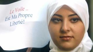 A woman takes part in a 2004 protest against a French ban on Muslim headscarves in schools