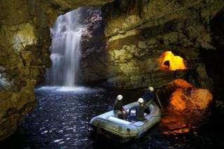 """The photo was taken inside Smoo Cave on Sunday late afternoon, when the last boat of tourists of the day was still exploring the cave."""""""