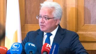 Justice Minister Ionas Nicolaou announcing resignation