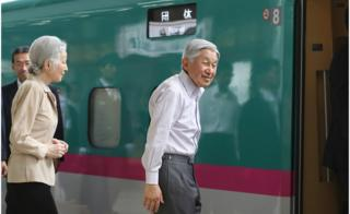 The Emperor and his wife board a bullet train in Tokyo