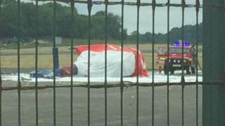 Helicopter flipped onto its side at Fermanagh airport