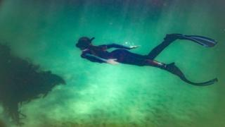 A free diver approaches a Kelp forest in the Indian Ocean, False Bay, Cape Town - Saturday 21 March 2020