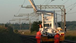 Rail engineers working on overhead lines