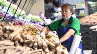 Woman in vegetable market