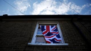 Union Jack hangs in window