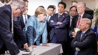 Dalam foto yang disediakan oleh kantor pers Pemerintah Jerman, Donald Trump menghadapi para pemimpin dunia pada KTT G7 pada bulan Juni
