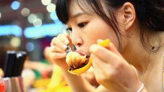 Woman eating dumplings