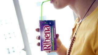 someone-drinking-from-ribena-carton