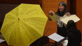 "Leung Kwok-hung - known as ""Long Hair"" - of the League of Social Democrats shouts slogans and rips up the ""831 ruling"" before taking the Legislative Council Oath"
