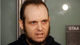 Joshua Boyle speaks to the media after arriving with his wife and three children at Toronto Pearson International Airport,