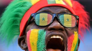 A Senegal fan cheers before the start of the Russia 2018 World Cup Group H football match between Senegal and Colombia at the Samara Arena in Samara on June 28, 2018.