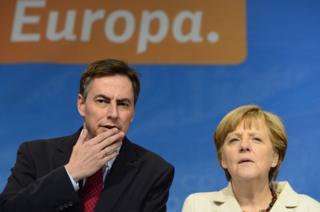 German MEP David McAllister with Chancellor Angela Merkel, file pic