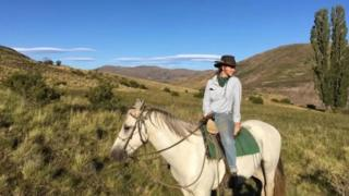 Annabel Symes poses on horseback