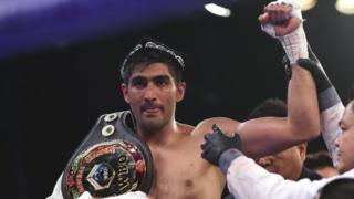 Indian boxer and WBO Asia-Pacific Super Middleweight champion Vijender Singh celebrates after defeating China's Zulpikar Maimaitiali in Mumbai on 5 August 2017.