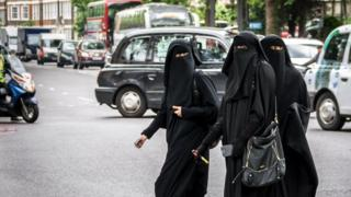 Muslim women cross a road in west London, File photo - May 2014