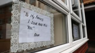A message from a resident in the window of a care home
