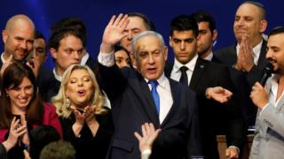 Israeli Prime Minister Benjamin Netanyahu waves to supporters at his Likud party's election headquarters on 3 March 2020