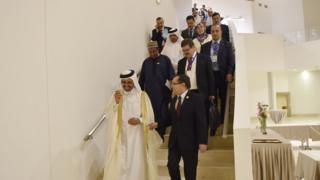 OPEC ministers on way to news conference after meeting in Algiers