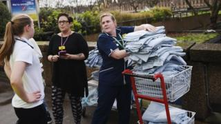 Nurses from St Thomas's Hospital pile up blankets for the injured.