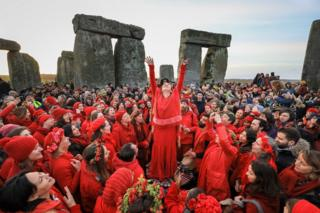 Druids, pagans and revellers gather at Stonehenge, hoping to see the sun rise, as they take part in a winter solstice ceremony at the ancient neolithic monument of Stonehenge