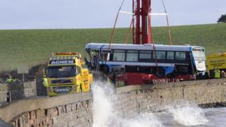 A bus that crashed onto a beach near Newtownards, County Down, has been removed.