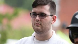 """James Alex Fields Jr pictured at """"Unite the right"""" rally before the car attack. Standing in a white polo shirt."""