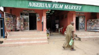 A man walks past the entrance of the Nigerian film market in Lagos on March 26, 2010.