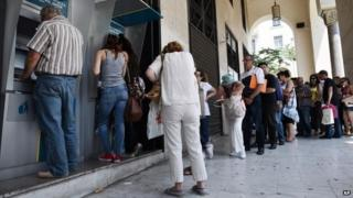 People queuing outside a cashpoint in Greece